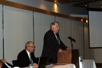 On left is PPAO Secretary Rick Metcalfe, as Paul Bailey addresses delegates