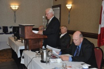 Colin Vrooman at the podium presenting this years financial report.