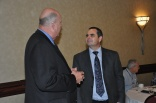Phil Slack, PPAO Benefits and Insurance Chair having a discussion with David Kurt, D. A. Kurt Insurance.